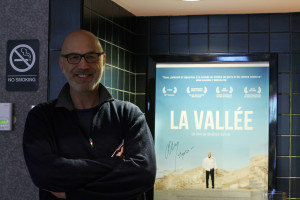 57.6 - Lebanese Actor (and Director) Carlos Chahine next to the poster of his movie The Valley - Photo by Eve Comperiati